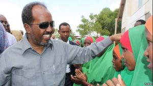 omali President Hassan Sheikh Mohamud is greeted by children at Dadaab refugee camp in eastern Kenya, June 6, 2016. The camp, established in the early 1990s, houses more than 300,000 displaced Somalis. (via @TheVillaSomalia)
