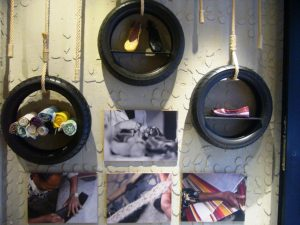 At the soleRebels shop in the Gràcia district of Barcelona, shoes are displayed in tyres, above photos of the production process in Ethiopia. TRF/Megan Rowling