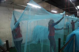 Workers look for holes in mosquito netting at the A to Z Textile Mills factory producing insecticide-treated bednets in Arusha, Tanzania, May 10, 2016. REUTERS/Katy Migiro