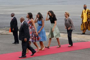 Michelle Obama arrives at Robert International Airport near Harbel, Liberia, on Monday, with her daughters Sasha and Malia and her mother Marian Robinson. (Thierry Gouegnon/Reuters)