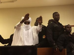 Chad's former dictator Hissène Habré raises his hands after sentencing during court proceedings on May 30 in Dakar, Senegal. Judge Gberdao Gustave Kam declared him guilty and sentenced him to life in prison for crimes against humanity, war crimes and torture. (Carley Petesch/AP)
