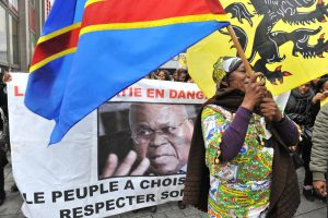 Congolese people in Belgium demonstrate with DRC flags and posters of opposition leader Étienne Tshisekedi following the re-election of Joseph Kabila in the country's 2011 elections, Antwerp, December 23, 2011. Tshisekedi rejected the election result and declared himself the president, which led to him being placed under house arrest. GEORGES GOBET/AFP/GETTY IMAGES