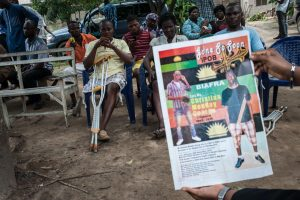 A man holds a poster of a pro-Biafra activist killed during demonstrations in Port Harcourt, Nigeria, May 3. Pro-Biafra protesters have had several deadly clashes with Nigerian security forces in recent months. STEFAN HEUNIS/AFP/GETTY IMAGES