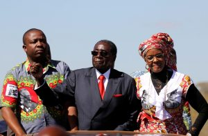 Zimbabwe's President Robert Mugabe and his wife Grace greet supporters at a pro-Mugabe rally in Harare, May 25. Mugabe has warned Zimbabwe's war veterans not to wade into the debate about who will succeed him as president. PHILIMON BULAWAYO/REUTERS