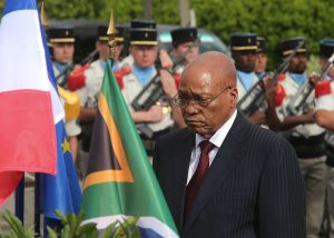 South African President Jacob Zuma (C) stands in front of a French and a South African flags as he takes part in a ceremony in Longueval, northern France to commemorate the centenary of the Battle of Delville Wood on July 12, 2016 (AFP Photo/Francois Nascimbeni)