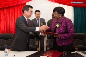 HARARE, June 10, 2016 (Xinhua) -- Chinese Ambassador to Zimbabwe Huang Ping (L, front) and Zimbabwe's Environment, Water and Climate Minister Oppah Muchinguri (R, front) exchange documents during a handover ceremony in Harare, Zimbabwe, June 9, 2016. Zimbabwe's state weather forecast department has tuned in to signals emitted from polar-orbiting Chinese satellites in a technological makeover aimed to improve the meteorological services of a country which relies on agriculture but has struggled to cope with irrationally changing weather patterns in recent years. (Xinhua/Xu Lingui)