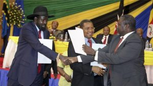South Sudan's President Salva Kiir and rebel leader Riek Machar come to an agreement to end the conflict and form a government of national unity in August 2015 [The Associated Press]