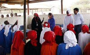 Malala Yousafza, left, with an escort, visits the Dadaab camp, in Kenya, Tuesday, July 12, 2016. Nobel laureate Malala Yousafzai is spending her 19th birthday in Kenya Tuesday visiting the world's largest refugee camp to draw attention to the global refugee crisis, especially as Dadaab camp faces pressure to close after a quarter-century. (AP Photo/Khalil Senosi)