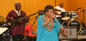 Anna Mwalagho on stage with her band