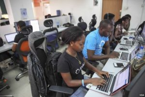 Andela fellow Tolu Komolafe works at the company's office on June 30, 2016 in Lagos, Nigeria. (Photo: Chris Stein for VOA)