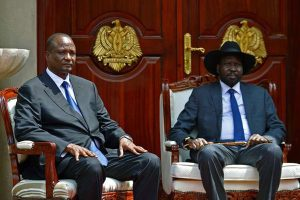 "Newly appointed Vice President of South Sudan, Taban Deng Gai (left) and South Sudan's President Salva Kiir pose at State House, in Juba on July 26, 2016. Kiir said he had appointed Taban Deng Gai to the post to replace former rebel leader Riek Machar on the ""recommendation of the top leadership of the SPLM/A (IO)"", the group Machar heads. Machar has warned of new war after his sacking. PHOTO 