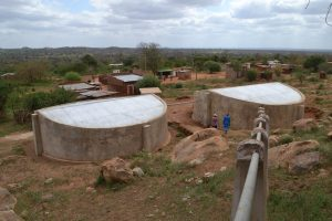 Captured rainfall runoff is piped to concrete tanks in Kikumbulyu, Kenya. TRF/Isaiah Esipisu