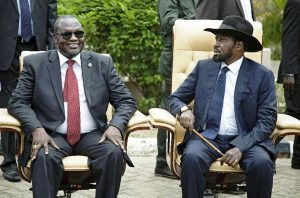 Once friends and now arch-rivals, South Sudan Vice President Riek Machar (L) and President Salva Kiir are both former rebel leaders who rose to power during Sudan's 1983-2005 civil war (AFP Photo/Albert Gonzales Farran)