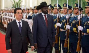 South Sudan's President Salva Kiir with China's former President Hu Jintao at a welcoming ceremony in Beijing