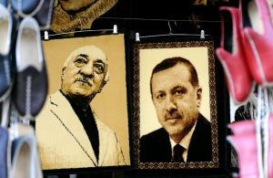 Embroidered images of Turkish cleric Fethullah Gulen (L) and Turkish President Recep Tayyip Erdogan (R) are pictured at a market in Gaziantep, Turkey, January 17, 2014. Erdogan has blamed Gulen for the failed coup that killed almost 250 people, which the U.S.-based cleric has denied. OZAN KOSE/AFP/GETTY IMAGES
