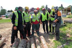 Farm Africa Field Extension Officer John Opio learning about health and safety in forestry management