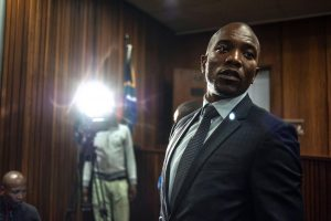 South Africa's opposition leader Mmusi Maimane celebrates a court ruling that corruption charges could be reinstated against President Jacob Zuma in Pretoria, April 29. Maimane, the opposition's first black leader, says Zuma is no longer fit to lead South Africa. MUJAHID SAFODIEN/AFP/GETTY IMAGES