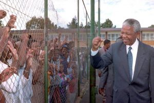 Nelson Mandela, the then-President of the African National Congress (ANC), greets supporters in Randfontein, South Africa, November 25, 1993. The use of Mandela's voice in an opposition party advert has riled the former president's grandson. WALTER DHLADHLA/AFP/GETTY IMAGES