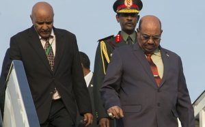 Sudan president Omar al-Bashir, right, arrives in Kigali, capital of Rwanda, Saturday, July 16, 2016. Al-Bashir arrived in Rwanda to attend a summit of African leaders, defying an international warrant of arrest after public assurances from Rwandan leaders that he would not be arrested. (Ssuuna katera/Associated Press)