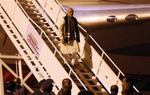 Indian Prime Minister Narendra Modi, center, arrives at the airport in Maputo, Mozambique, Thursday, July 7, 2016. India's prime minister has kicked off a four-nation African tour on a continent where China's presence has been strong, including countries that haven't been visited by an Indian leader in more than three decades. Schalk van Zuydam - AP Photo