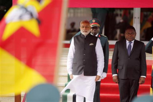 Indian Prime Minister Narendra Modi stands next to Mozambique's President Filipe Nyusi, right, during a guard of honor in Maputo, Mozambique, Thursday, July 7, 2016. Modi kicked off a four-nation African tour on a continent where China's presence has been strong, including countries that haven't been visited by an Indian leader in more than three decades. Schalk van Zuydam - AP Photo
