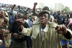 Zimbabwean war veterans sing revolutionary songs at a meeting at the ruling Zanu-PF.Reuters