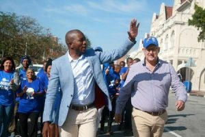 Democratic Alliance leader (D.A), Mmusi Maimane (L) and the mayoral candidate for Nelson Mandela Bay, Athol Trollip wave to their suppoters during their election campaign in Port Elizabeth, August 2,2016. REUTERS/Luvuyo Mehlwana