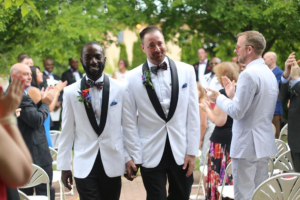 LUKE REYNOLDS PHOTOGRAPHY Eric Shoen-Ukre and David Shoen-Ukre walked down the aisle for the first time as a legally married couple.