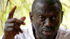 FILE - Opposition leader Kizza Besigye speaks during a news conference at his home at the outskirts of Kampala, Uganda, Feb. 21, 2016.