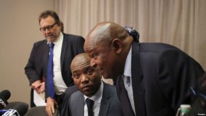Leader of South Africa's Democratic Alliance (DA) Mmusi Maimane looks on next to Congress of the People (COPE) leader Mosiuoa Lekota, ahead of a media briefing in Sandton, South Africa August 17,2016.