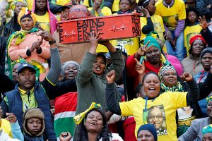 Supporters of the African National Congress (ANC) carry a mock coffin of the opposition South Africa's Economic Freedom Fighters (EFF) during ANC's traditional Siyanqoba rally ahead of the August 3 local municipal elections in Johannesburg, South Africa on July 31, 2016.