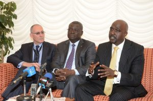 Dr. Andrew Mude (right) during a press conference