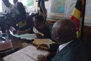 Eng Irene Muloni signs petroleum production licenses for Tullow Oil and Total, which could invest billions of dollars in the country's emerging oil industry. Photo courtesy Uganda Ministry of Energy and Mineral Development/