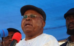 FILE-In this file photo dated Wednesday, July 31, 2016, Congo opposition leader Etienne Tshisekedi speaks during a political rally in Kinshasa, Congo. The coalition, recently formed by popular opposition leader Etienne Tshisekedi, called for a general strike on Tuesday, Aug. 23, 2016, to protest talks meant to ease tensions ahead of upcoming elections. (AP Photo/John Bompengo,File)