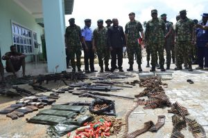 The Nigerian military parades weapons and some suspected members of the Niger Delta Avengers after their arrest in the Nembe waters, Rivers state, on August 22. The Avengers claim to have ceased hostilities against oil companies and the Nigerian government. STRINGER/REUTERS