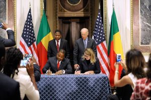 File Picture.Benin Minister of Finance Komi Koutche, left, and MCC CEO Dana J. Hyde, signing the $375 million Benin Power Compact in the presence of Benin President Dr. Thomas Boni Yayi, and Vice President Joe Biden .The compact was in large part the fruit of hard work put in by Arouna to redeem the image of Benin in the eyes of Washington,DC.Photo credit MCC