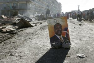 """An election poster of opposition leader Odinga marks the """"border"""" between rival supporters during ethnic violence, Nairobi, January 2, 2008. Months of bloodshed followed Kenya's controversial 2007 elections, which Odinga maintains were rigged against him. THOMAS MUKOYA/REUTERS"""