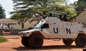 U.N. peacekeepers patrol outside a vote-counting center in Bangui, Central African Republic, January 2. The war-torn country hosts almost 11,000 peacekeepers and 2,000 U.N. police. ISSOUF SANOGO/AFP/GETTY IMAGES
