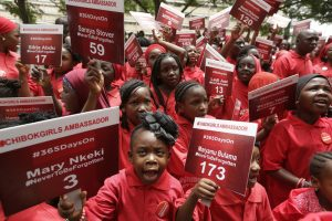 Young girls known as Chibok Ambassadors, carry placards bearing the names of the girls kidnapped from the government secondary school in Chibok in April 2014 in Abuja, Nigeria. Nigerian President Muhammadu Buhari is inviting the United Nations to help negotiations to swap the kidnapped schoolgirls from Chibok for detained leaders of the Boko Haram Islamic extremist group.