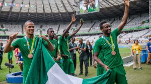 Happier times: Nigeria's players William Ekong (L) and John Obi Mikel (R) celebrate with bronze medals at the Rio 2016 Olympics. A Japanese fan gifted the cash-strapped team $390,000 after the match