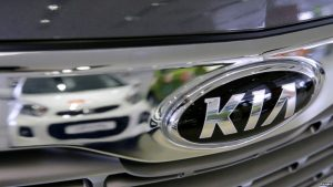 FILE - A Kia car is reflected at the showroom of the Avtomir company, a Kia cars dealership, in Moscow, Russia, March 11, 2016