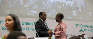 AfDB President Akinwumi Adesina with Rwanda's Foreign Minister Louise Mushikiwabo, at the 35th Session of the NEPAD Heads of State and Government Orientation Committee meeting in Kigali on July 16, 2016