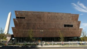 The Washington Monument rises behind the National Museum of African American History and Culture on the National Mall in Washington, Sept. 14, 2016.