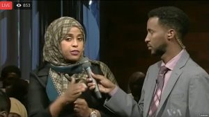 """A moderator, right, and participant in the VOA Somali service's """"Mogadishu-Minnesota"""" town hall meeting are seen in a screen grab from its Facebook stream."""