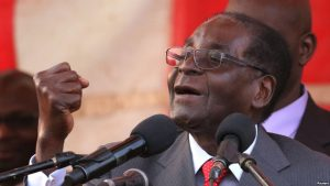 Zimbawe's president, Robert Mugabe, gestures as he addresses supporters of his ruling ZANU-PF party at Harare International Airport, Zimbabwe, Sept. 24, 2016