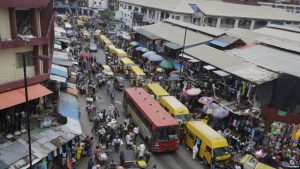 FILE - In this photo taken June 20, 2016, pedestrians shop at a market in Lagos, Nigeria.