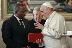 Pope Francis talks with Congo President Joseph Kabila during a private audience in the pontiff's studio, at the Vatican, Monday, Sept. 26, 2016. (Andrew Medichini/Associated Press)