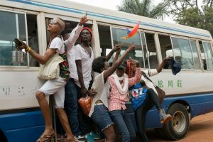"""Members of Uganda's gay and transgender community yell """"we want peace"""" after police forced them to leave the gay pride festival in Entebbe, Uganda, Saturday, Sept. 24, 2016. Ugandan police on Saturday prevented organizers from holding a gay pride parade on the orders of a government minister who said such an event is illegal. (AP Photo/Katie G. Nelson)"""