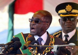"FILE - In this Monday, Aug. 8, 2016 file photo, Zimbabwean President Robert Mugabe addresses party supporters during a gathering to honor the country's dead heroes, at the National Heroes Acre in Harare. Zimbabwe's 92-year-old President Robert Mugabe arrived home Saturday, Sept. 3, 2016 after an overseas absence that led to rumors about a health crisis, joking to reporters that ""Yes, I was dead."" ""It is true that I was dead,"" the world's oldest head of state said. ""And I resurrected. As I always do."" (AP Photo/Tsvangirayi Mukwazhi, file) Less HARARE, Zimbabwe ("