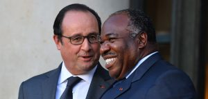 Gabon's President Ali Bongo Ondimba (R) leaves Elysee Palace after a press conference with French President Francois Hollande (L) regard to the COP 21 meeting in Paris, France on November 10, 2015. (Photo by Mustafa Yalcin/Anadolu Agency/Getty Images)